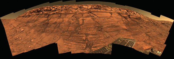 Layered sediments in the wall of Endurance Crater, Mars. Photograph courtesy NASA.